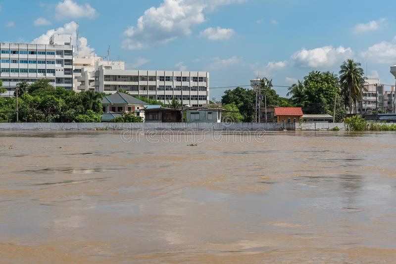 Dams from sand bags prevent flooding from river. Ang Thong, Thailand - October 21, 2017 : Dams created from sand bags. To prevent flooding caused by heavy rain stock photos