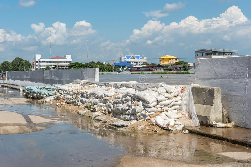 Dams from sand bags prevent flooding from river. Ang Thong, Thailand - October 21, 2017 : Dams created from sand bags. To prevent flooding caused by heavy rain royalty free stock photos
