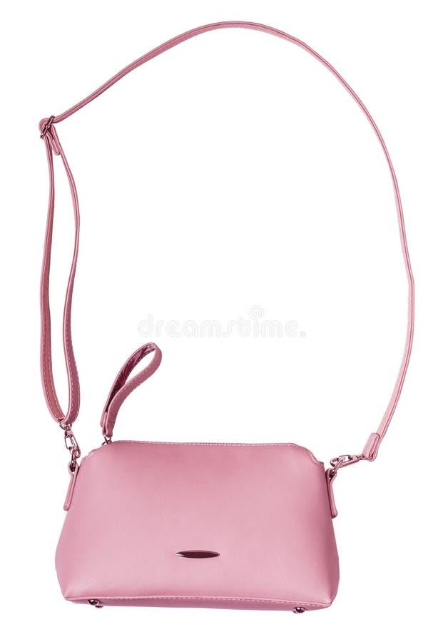 Damy różowią pastelową torebkę z długą patką Odizolowywa na bielu obrazy royalty free