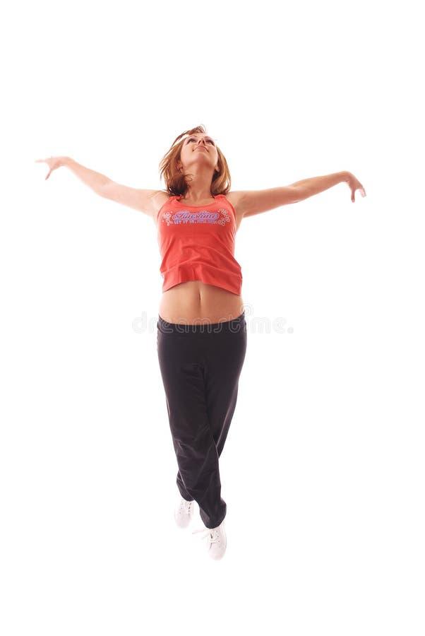 Dança adolescente atrativa sobre o fundo branco fotografia de stock royalty free