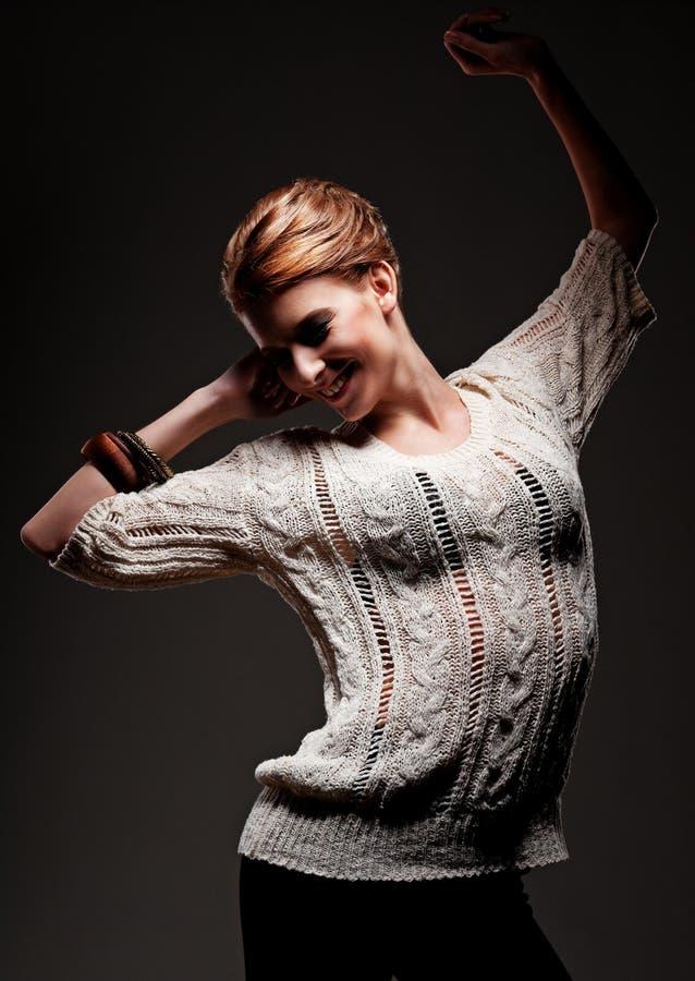 Dança Alegre Da Mulher Nova Fotografia de Stock Royalty Free