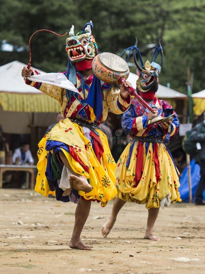 Dança butanesa da máscara do homem poderoso, dragão e Garuda, Butão fotografia de stock