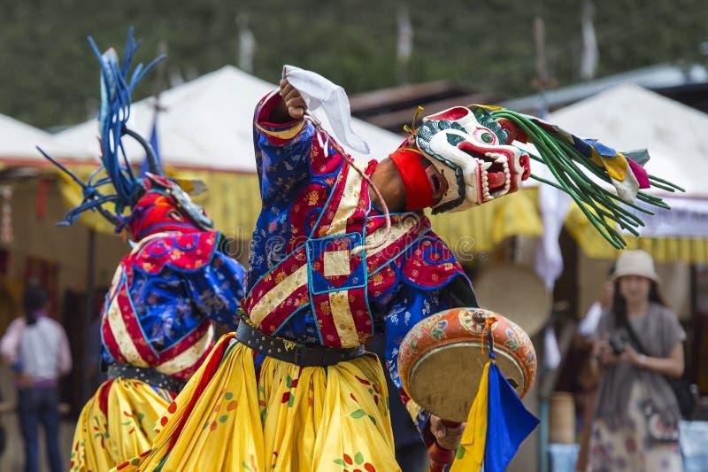 Dança butanesa da máscara do homem poderoso, leão da neve e Garuda, Butão fotografia de stock