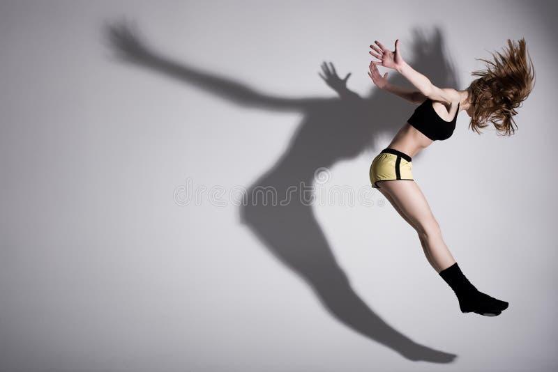 Dança com sombra fotografia de stock