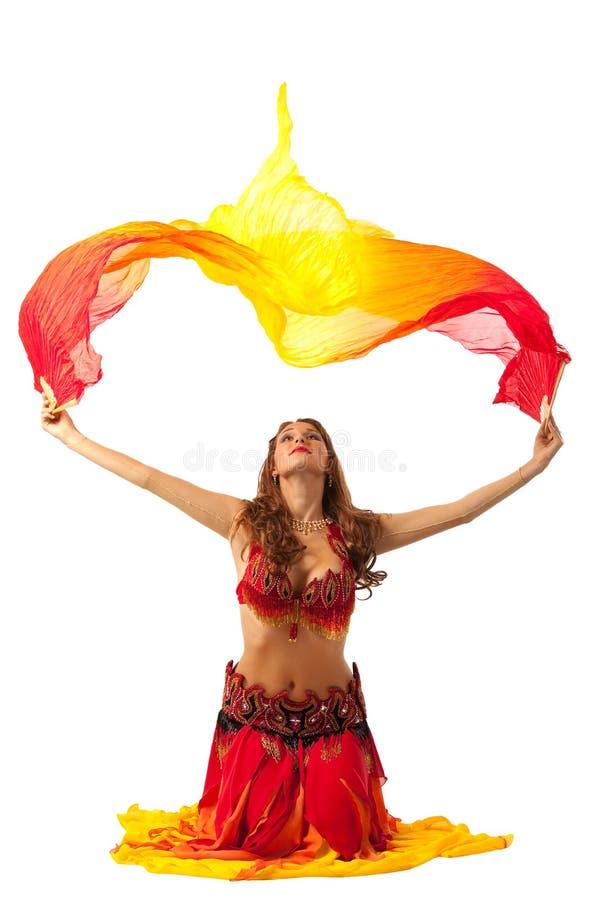 Dança da mulher com o fantail no traje oriental fotografia de stock royalty free
