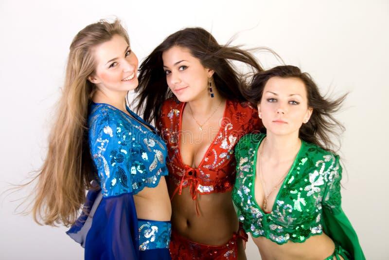 Dança de barriga de três meninas imagem de stock