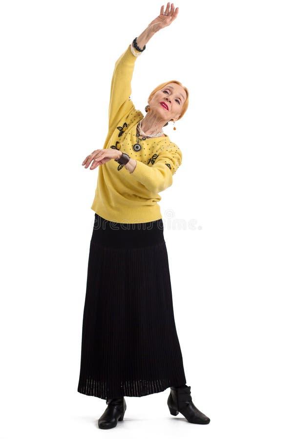 A dança idosa da mulher isolou-se fotografia de stock