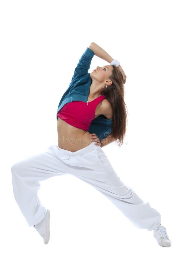 Dança magro consideravelmente moderna nova da mulher do estilo de hip-hop foto de stock