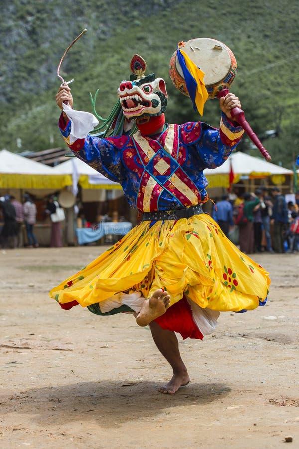 Dança principal da deidade do leão da neve, dança butanesa da máscara do homem poderoso, Butão foto de stock