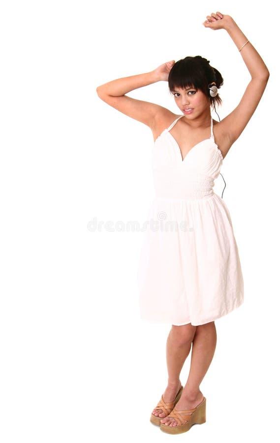 Dança triguenha bonita e fotografia de stock