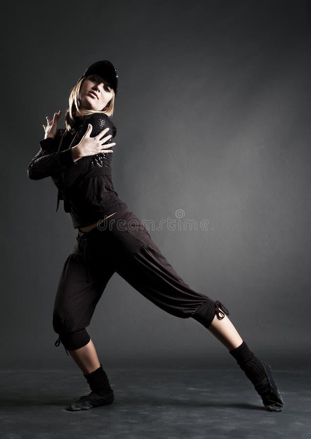 Dançarino da paixão na roupa preta fotografia de stock royalty free