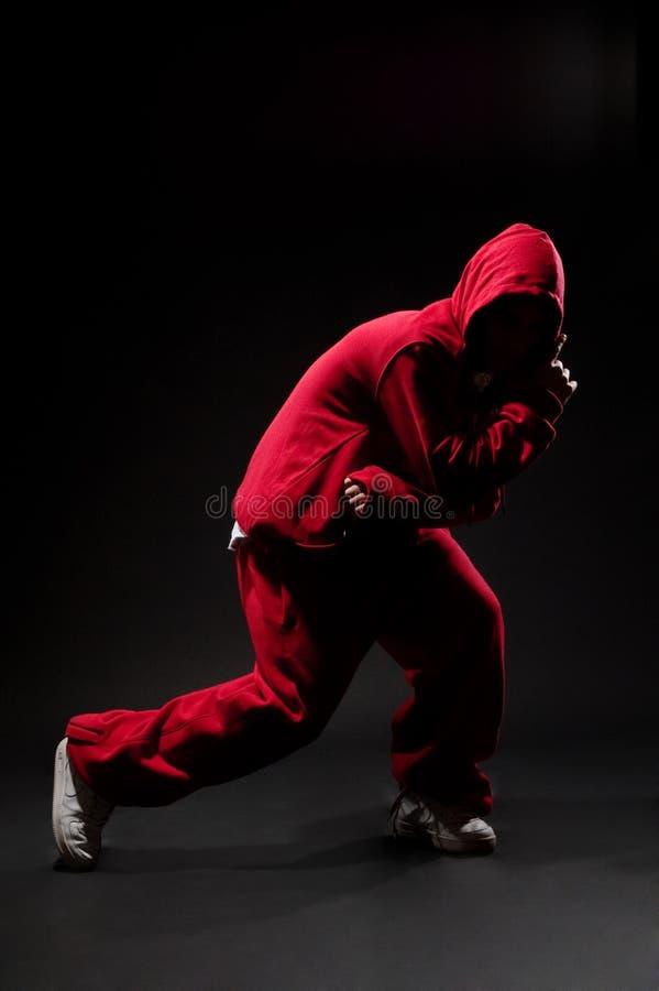 Dançarino da rua no vermelho imagens de stock