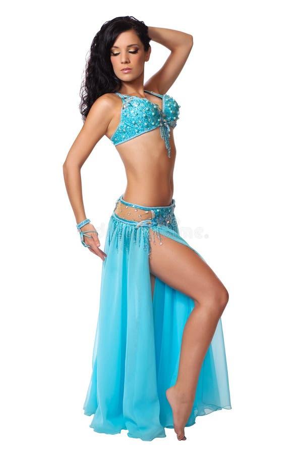 Dançarino de barriga que desgasta uma luz - traje azul imagens de stock