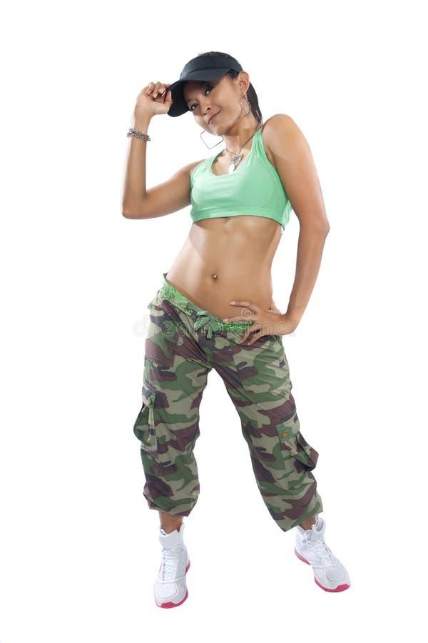 Dançarino do lúpulo do quadril da mulher que golpeia um pose da dança imagem de stock