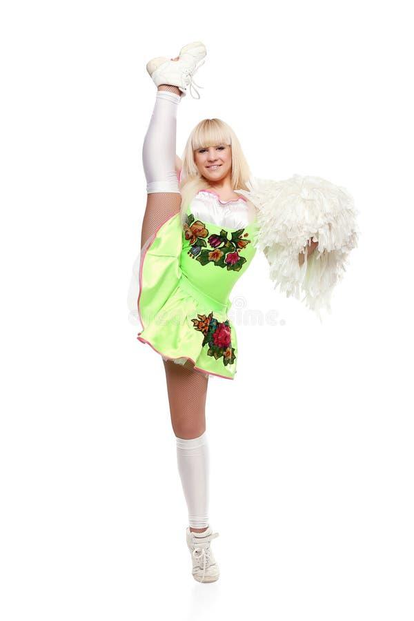 Dançarino fêmea novo da High School que está com os pom-poms no fundo branco isolado imagens de stock