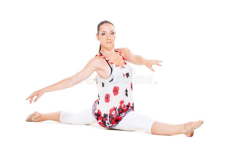 Dançarino flexível sobre o fundo branco foto de stock