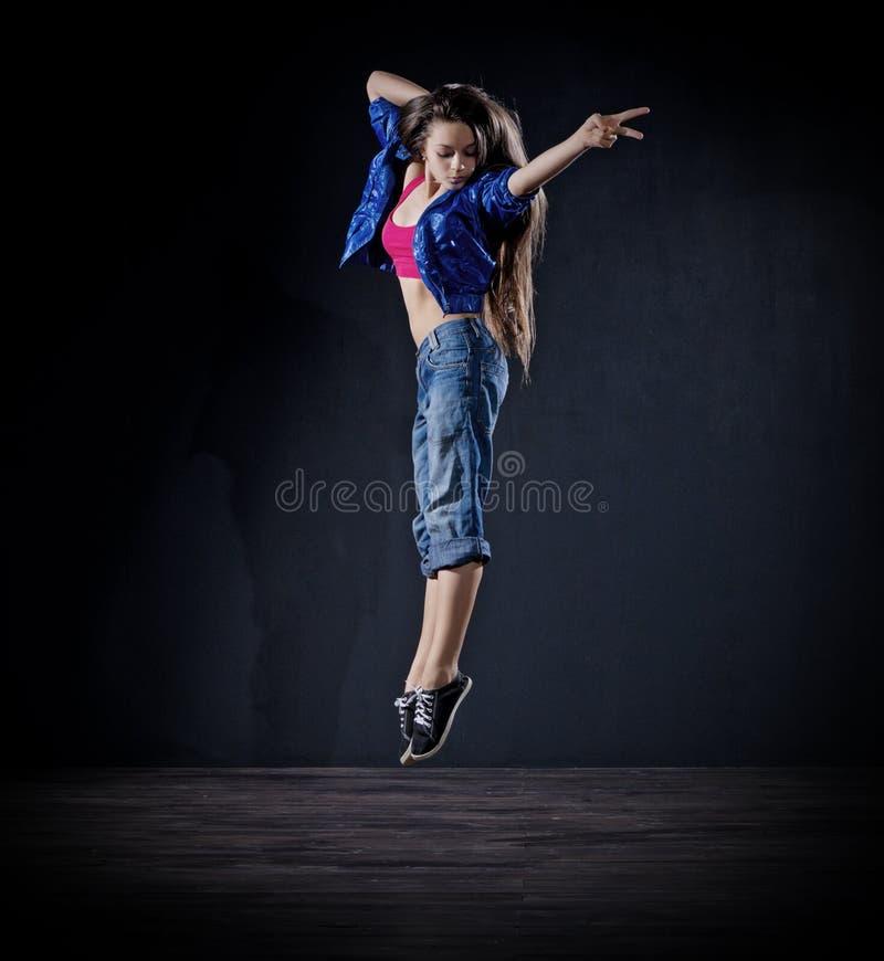 Dançarino moderno da moça (ver escuro) foto de stock royalty free