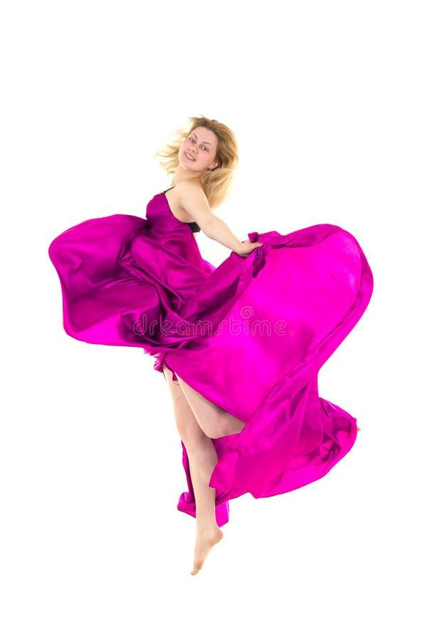 Dançarino novo no salto cor-de-rosa do vestido imagem de stock