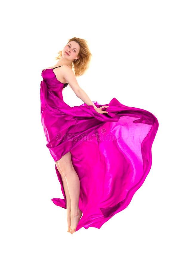 Dançarino novo no salto rosado do vestido fotografia de stock
