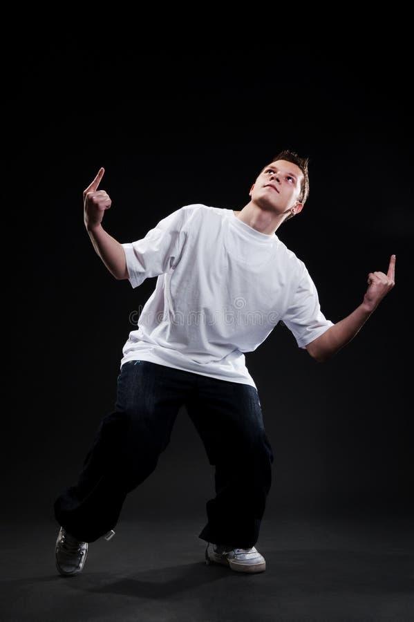 Dançarino novo que aponta acima foto de stock royalty free