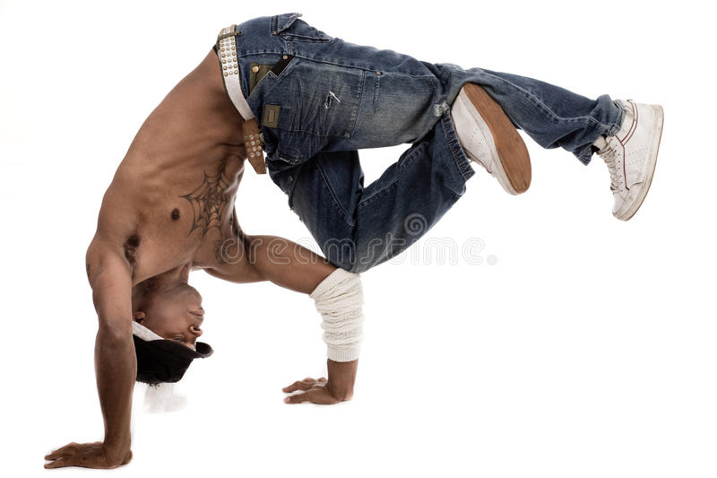 Dançarino que balança seus joelhos com seus cotovelos fotografia de stock