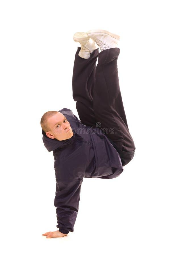 Dançarino que está em uma mão foto de stock