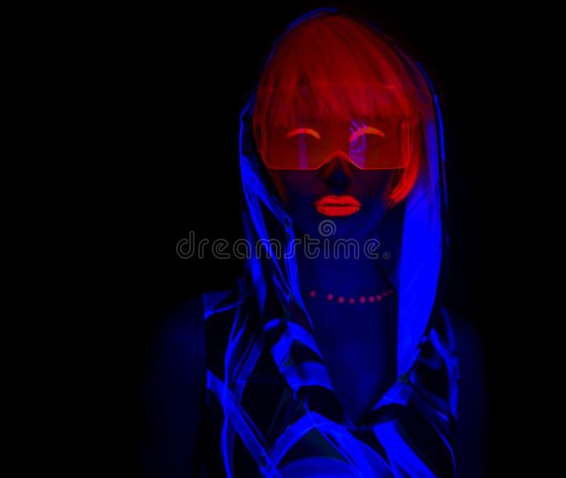 Dançarino uv de néon 'sexy' do fulgor fotografia de stock