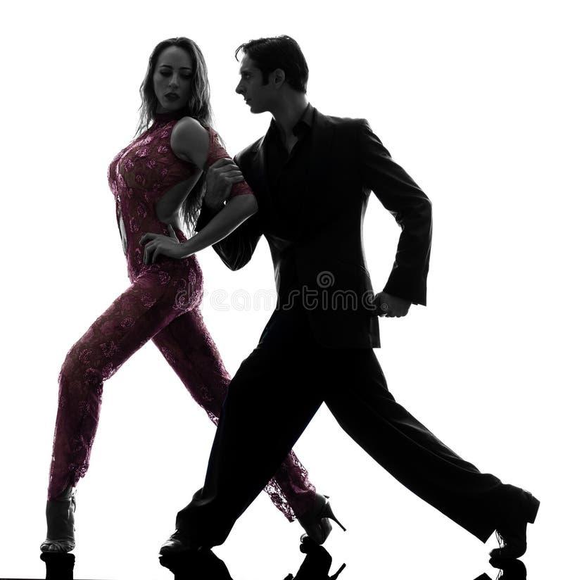 Dançarinos do salão de baile da mulher do homem dos pares que tangoing o silhou imagem de stock