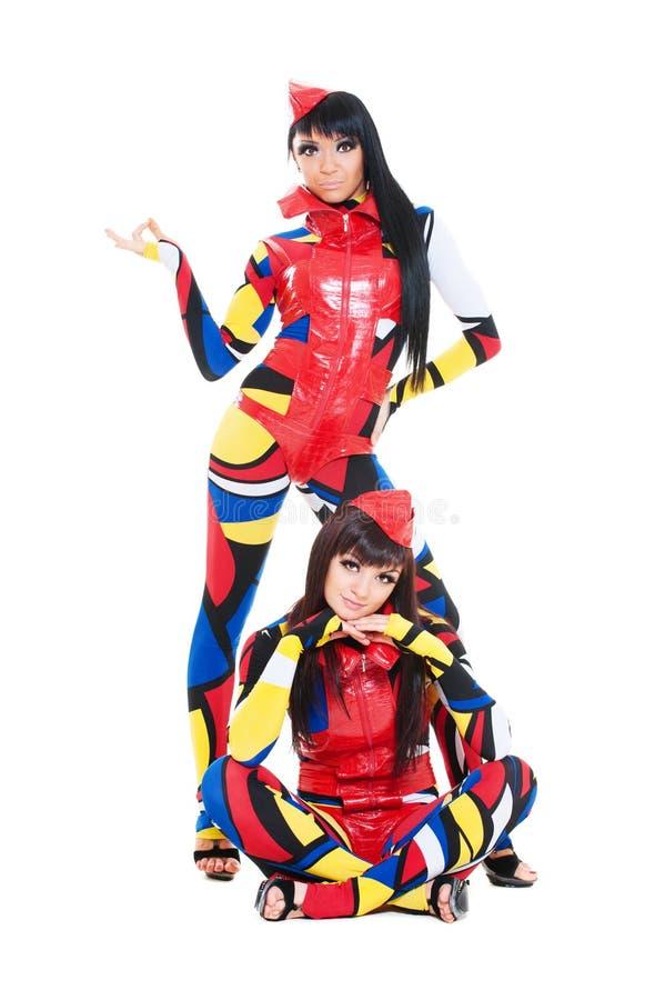 Dançarinos em trajes coloridos foto de stock