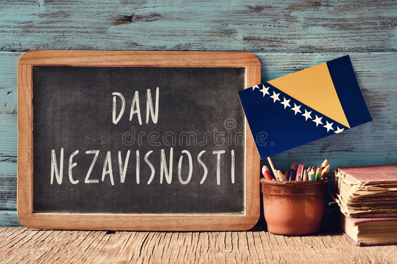 Dan Nezavisnosti, Independence Day of Bosnia and Herzegovina. A chalkboard with the text Dan Nezavisnosti, Independence Day written in Bosnian, a pot with royalty free stock images