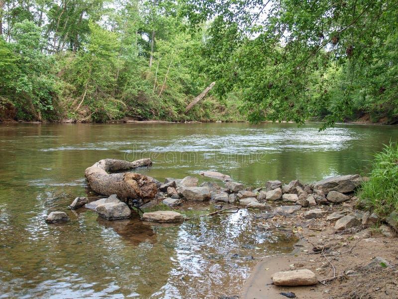 Dan River in Danbury, North Carolina. A calm section of the Dan River near Danbury, North Carolina royalty free stock photo