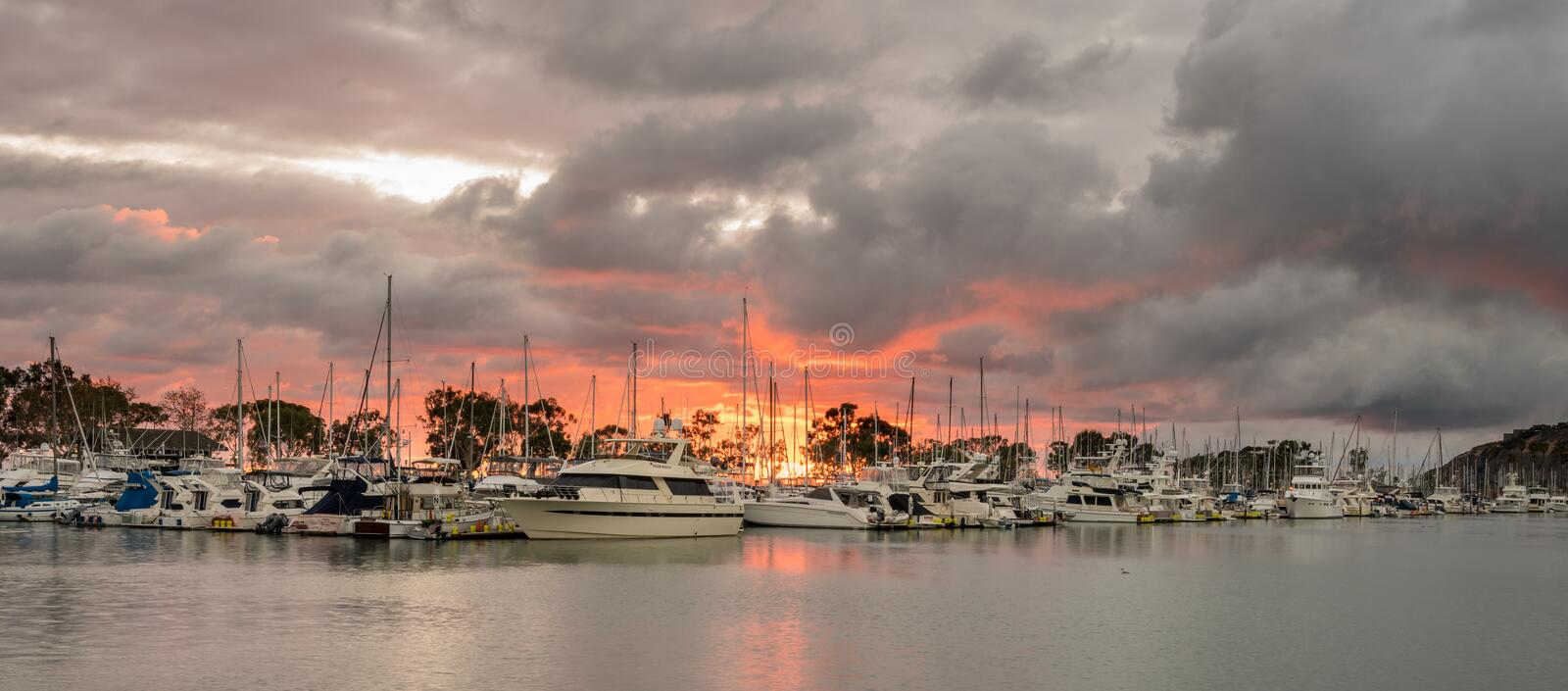 Sunset over harbor at Dana Point in California royalty free stock photography