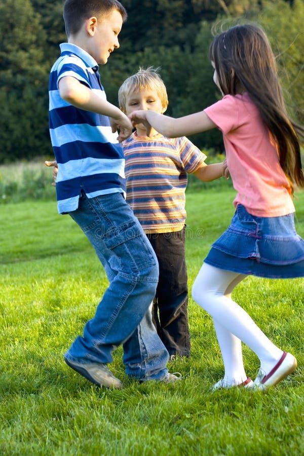 Dance. Dancing children on a meadow