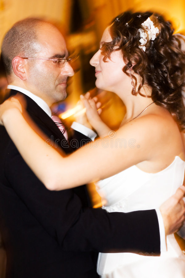 Dance. Beautiful couple - bride and groom - dancing. Iso 800! Reporting shoot royalty free stock image