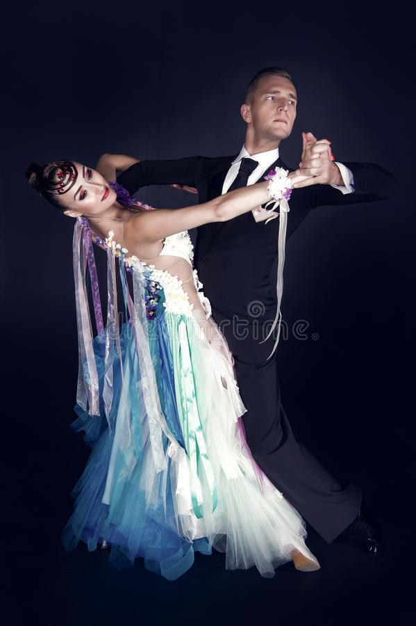 Dance ballroom couple in colorful dress dance pose on black background. sensual professional dancers dancing. Dance ballroom couple in red dress dance pose on stock photography