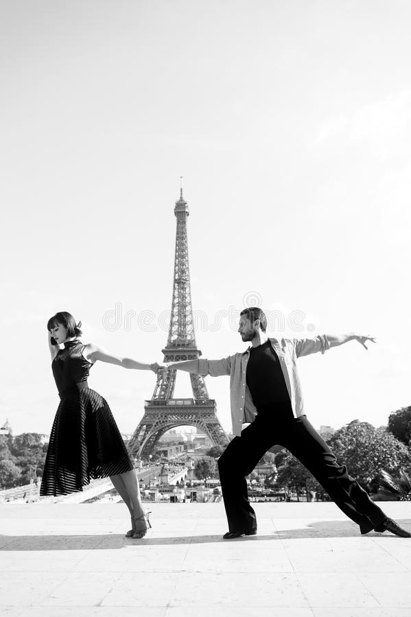 Dance couple in front of eifel tower in paris, france. beatuiful ballroom dance couple in dance pose near eifel tower stock photos