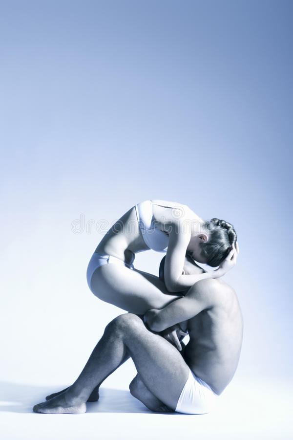 Dance Couple Performing Over Blue Background royalty free stock photo