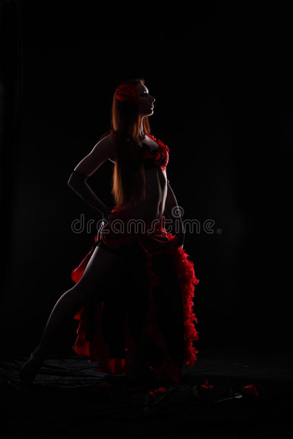 Dance in the darkness. Attractive woman dance in the darkness stock photo