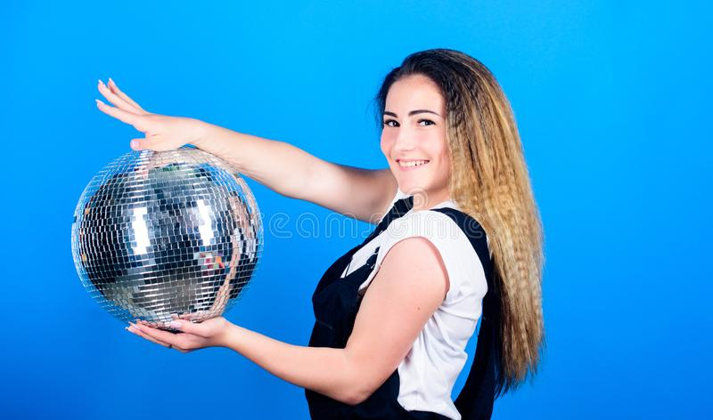 Dance until drop. Cheerful woman hold disco ball. Girl inviting at party. Mirrors reflecting lights disco atmosphere. How about party. Little party never stock photo