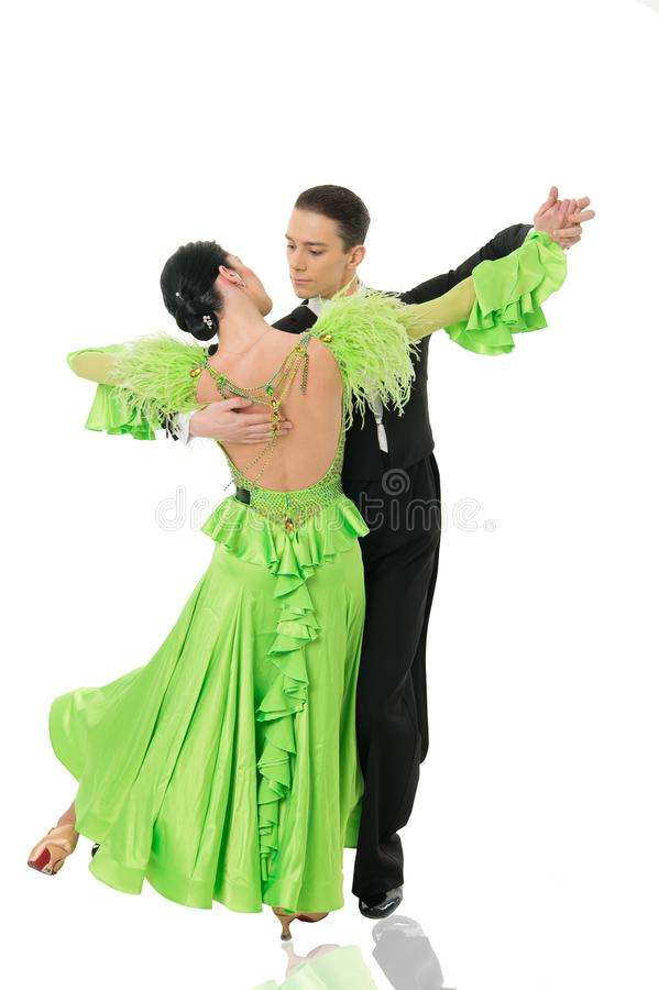 Ballroom dance couple in a dance pose isolated on white background. ballroom sensual proffessional dancers dancing walz. Dance expression. ballroom dance couple royalty free stock photo
