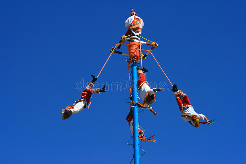 Dance of the Flyers. Mexico, Quintana Roo State, Tulum - Daring men from Papantla Veracruz perform the 'Dance of the Flyers' for tourists, a ceremony which is stock photo