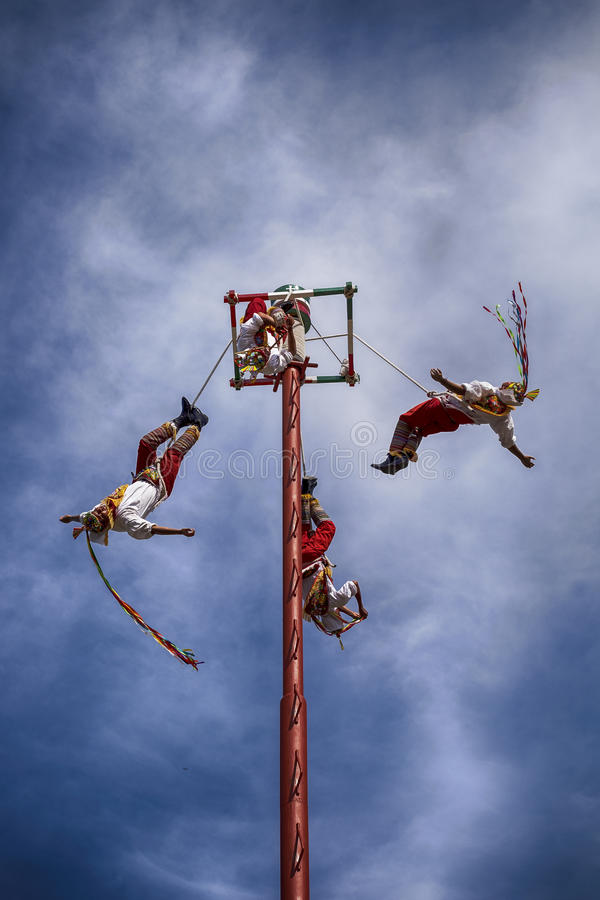 Dance Of The Flyers. IXTAPA, MEXICO - DECEMBER 24, 2015: The Danza de los Voladores (Dance of the Flyers), or Palo Volador (pole flying), is an ancient royalty free stock images