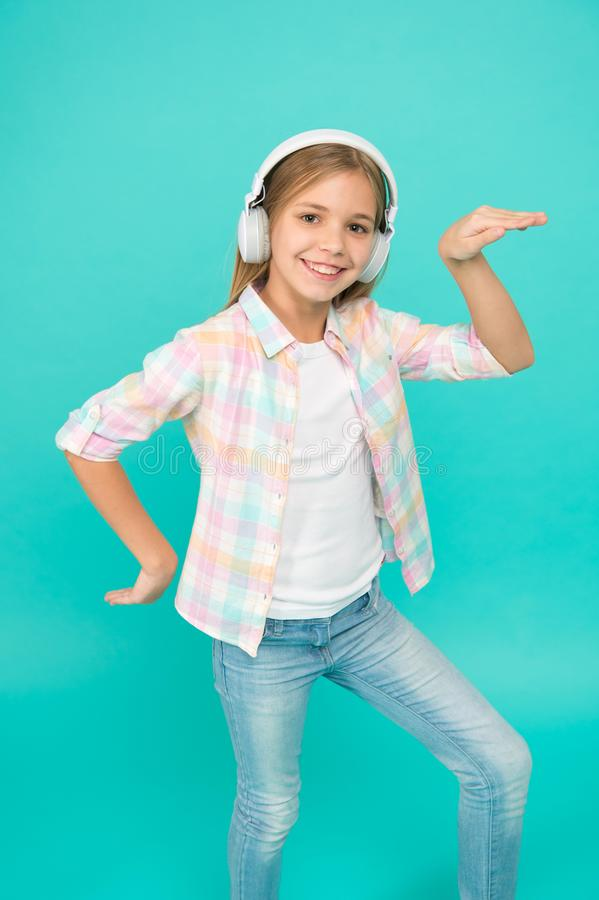 Dance folk dances. Girl child listen music with modern headphones. Kid little girl listen music headphones. Music stock photos