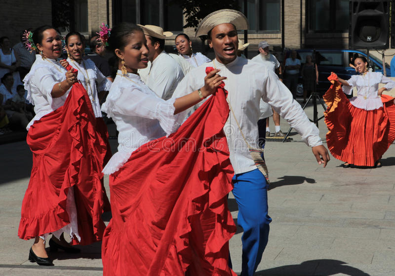 Dance group from Panama. Dancing a folk dance on the square at the festival of folk groups royalty free stock image