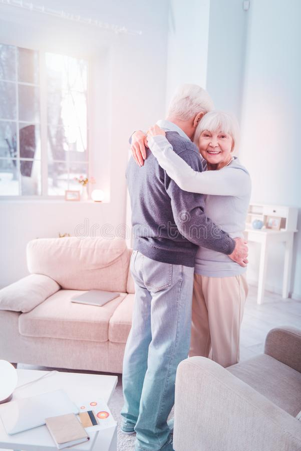 Stylish elderly lady wearing blue sweater dancing with husband royalty free stock photography