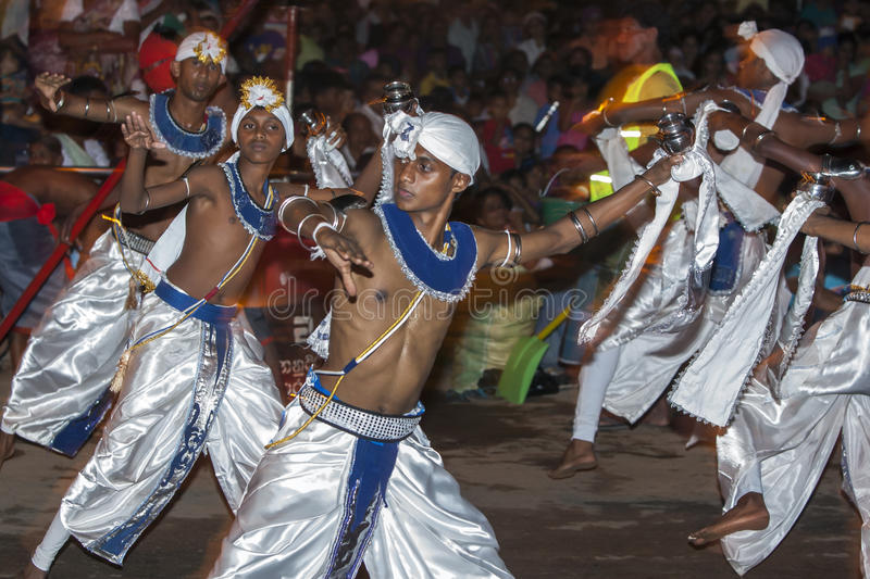 Dance of Kothala (Kothala Padhaya) performers at the Esala Perahera in Kandy, Sri Lanka. The dancers carry a pot of Pirith water (blessed water) which not only stock photography