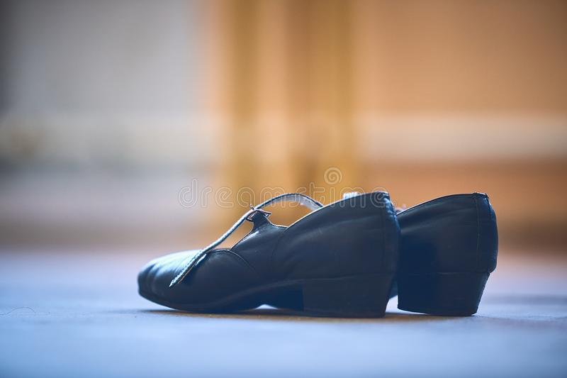 Dance leather shoes, standing on the floor stock photo