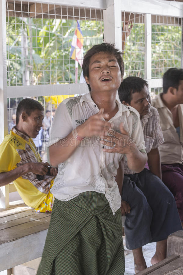 In dance. The people dancing in time of playing music on a traditional music instrument during the holidays religious in a small village in Myanmar (Burma royalty free stock photography