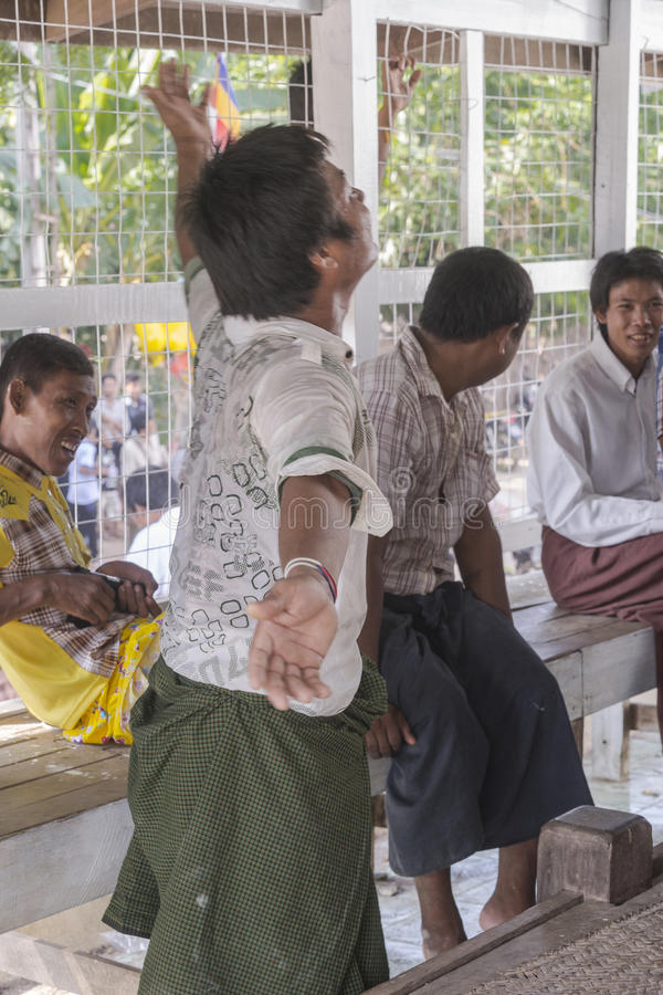 In dance. The people dancing in time of playing music on a traditional music instrument during the holidays religious in a small village in Myanmar (Burma royalty free stock images