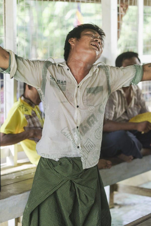 In dance. The people dancing in time of playing music on a traditional music instrument during the holidays religious in a small village in Myanmar (Burma stock photography